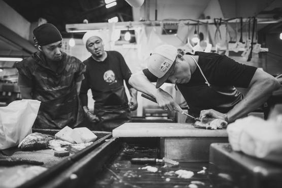 Travis Rice Guts a Fish