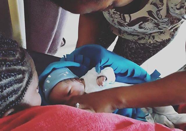 Atsede helps Tsehay's new baby boy to su