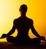 man-practicing-yoga-sunset-light.jpg