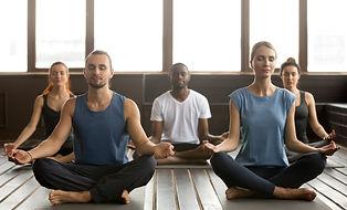 group-people-practicing-yoga-breathing-in-sukhasana.jpg