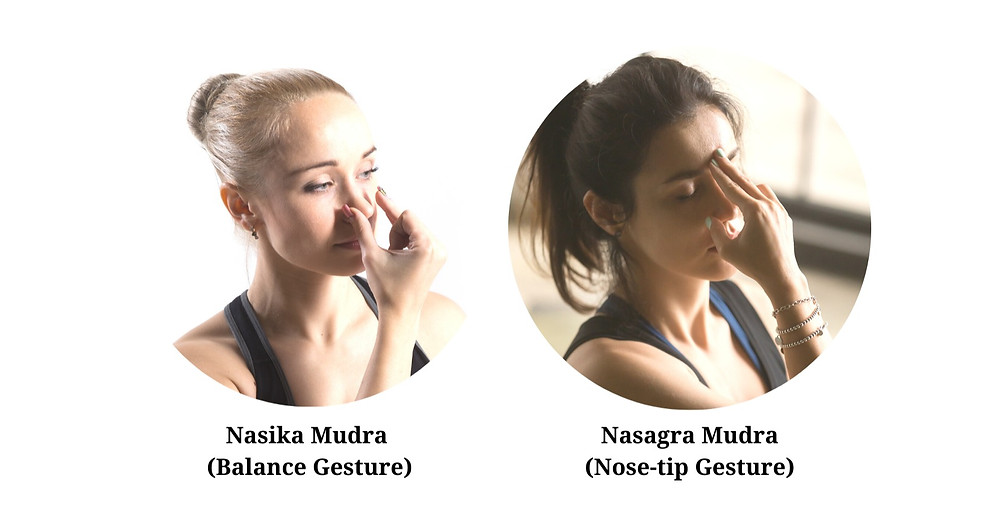 Woman doing Nasika Mudra with another woman doing Nasagra Mudra in yoga breathing (pranayama)