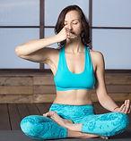 woman-making-alternate-nostril-breathing-using-Vishnu-Mudra.jpg