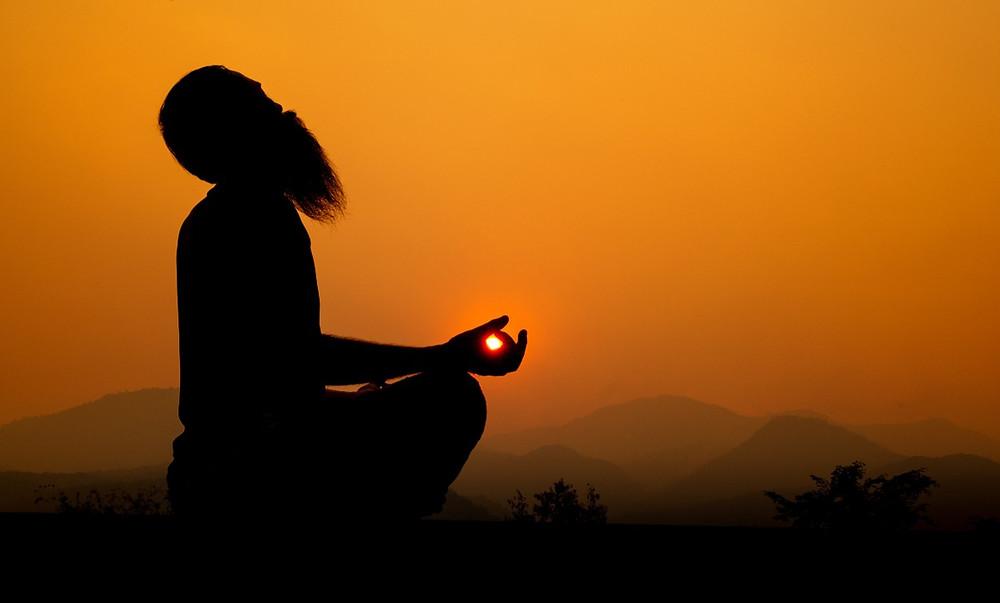 silhouette of man doing surya bhedana pranayama
