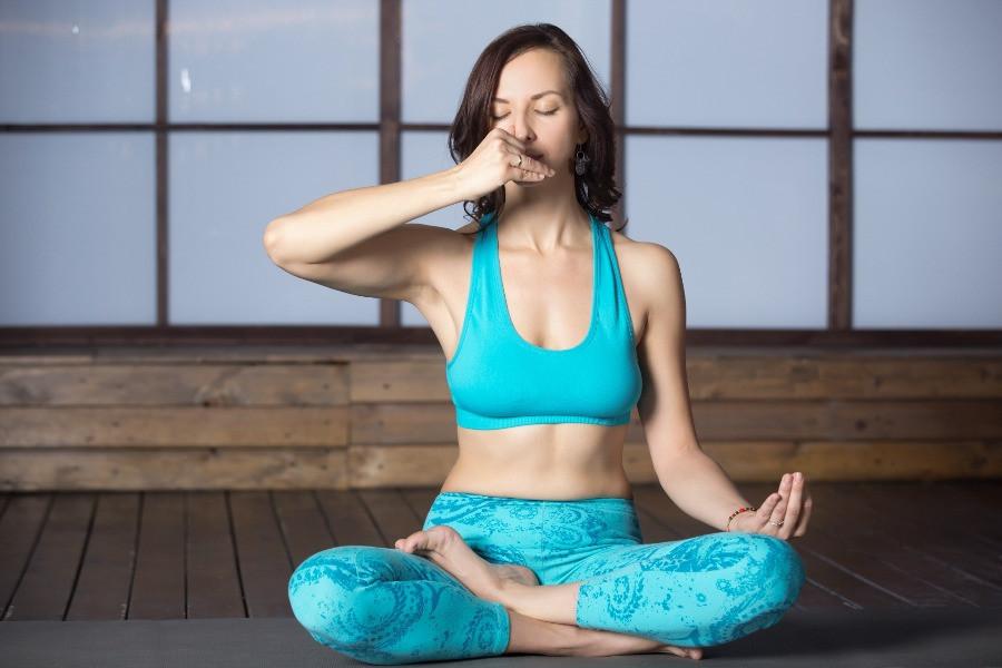 Woman using Vishnu Mudra during Alternate Nostril Breathing