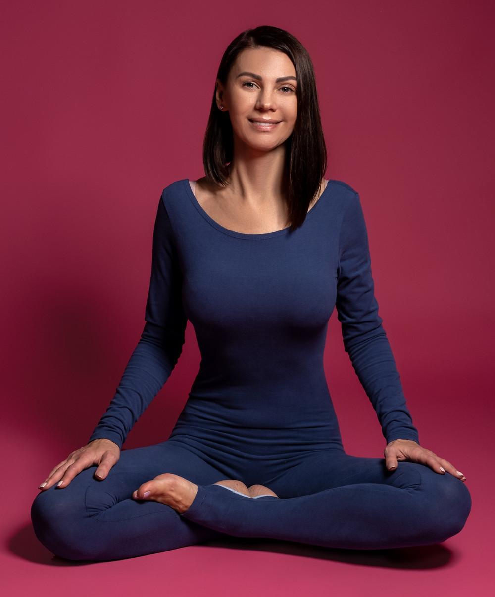 Yoga woman doing pranayama in Siddhasana