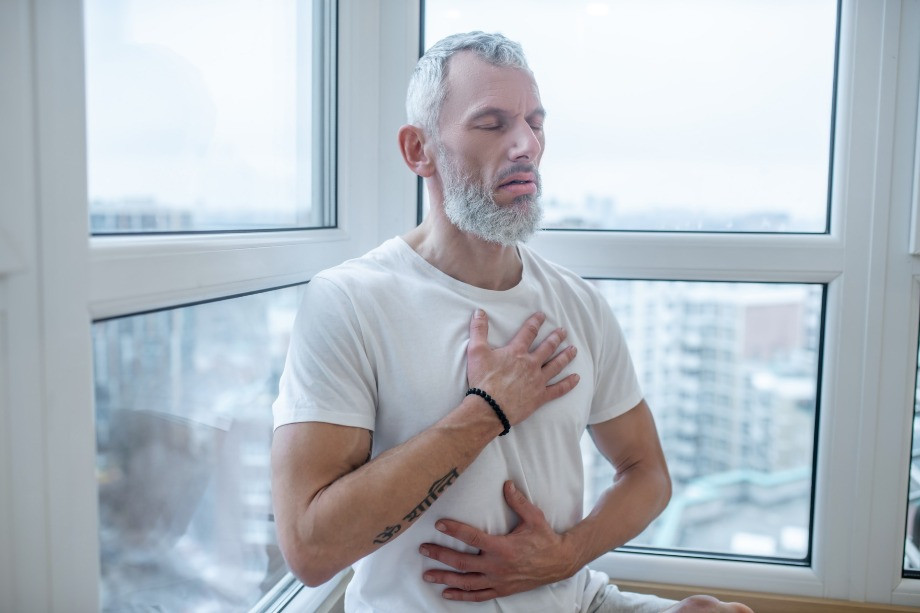 Mature man doing yoga three part breath