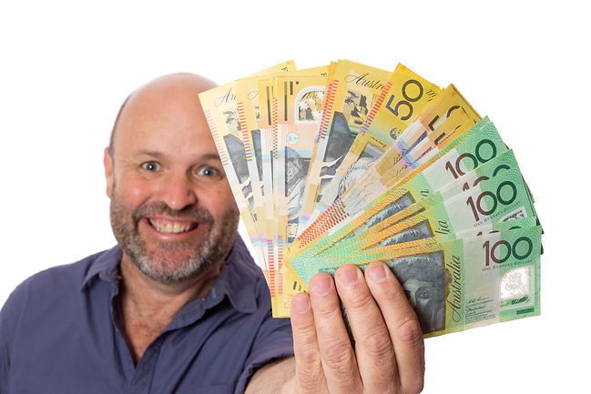 A happy man showing a wad of cash on whi