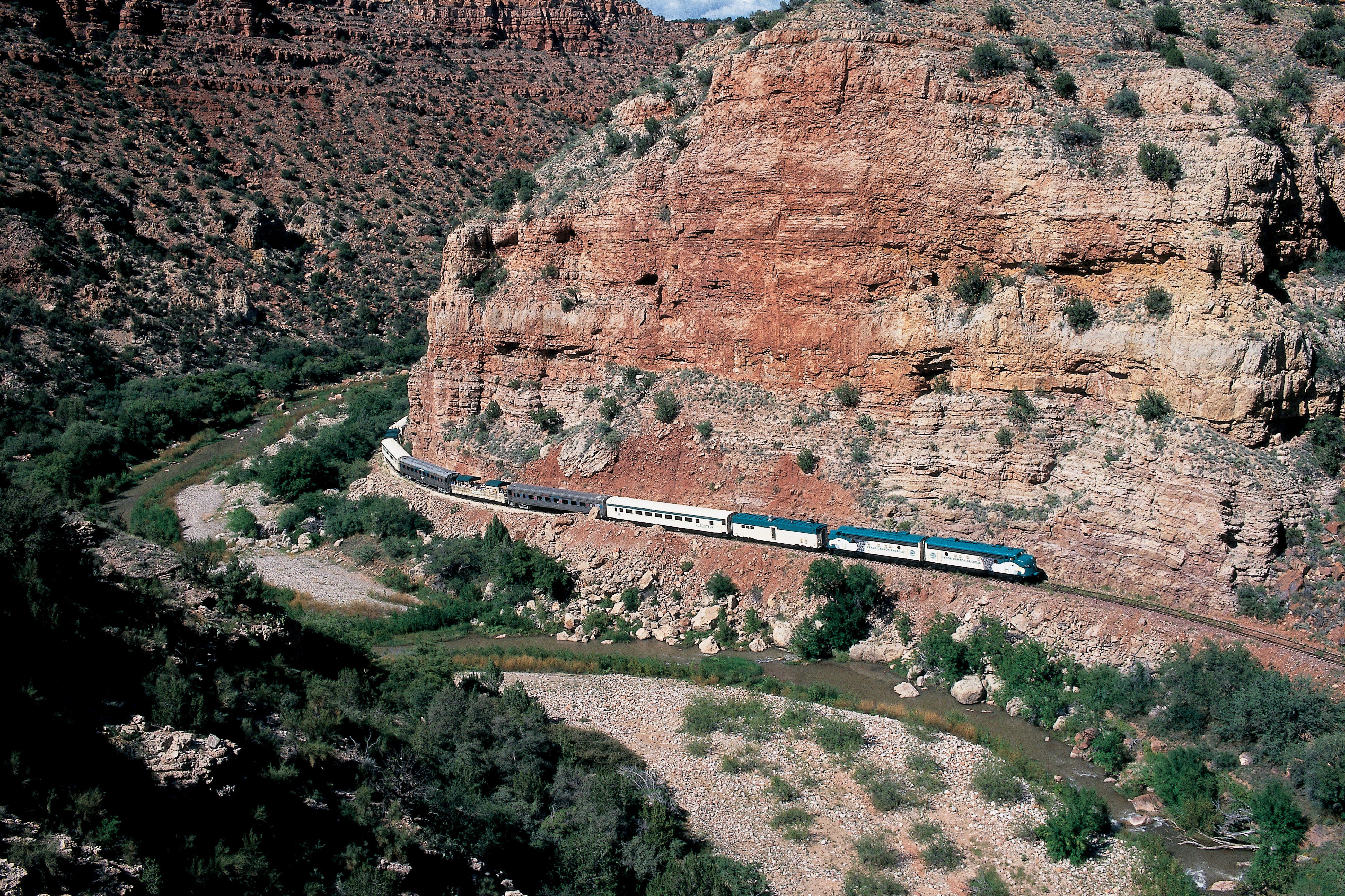 Distant Train above River with Red Rock