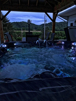 The hot tub under the covered patio.