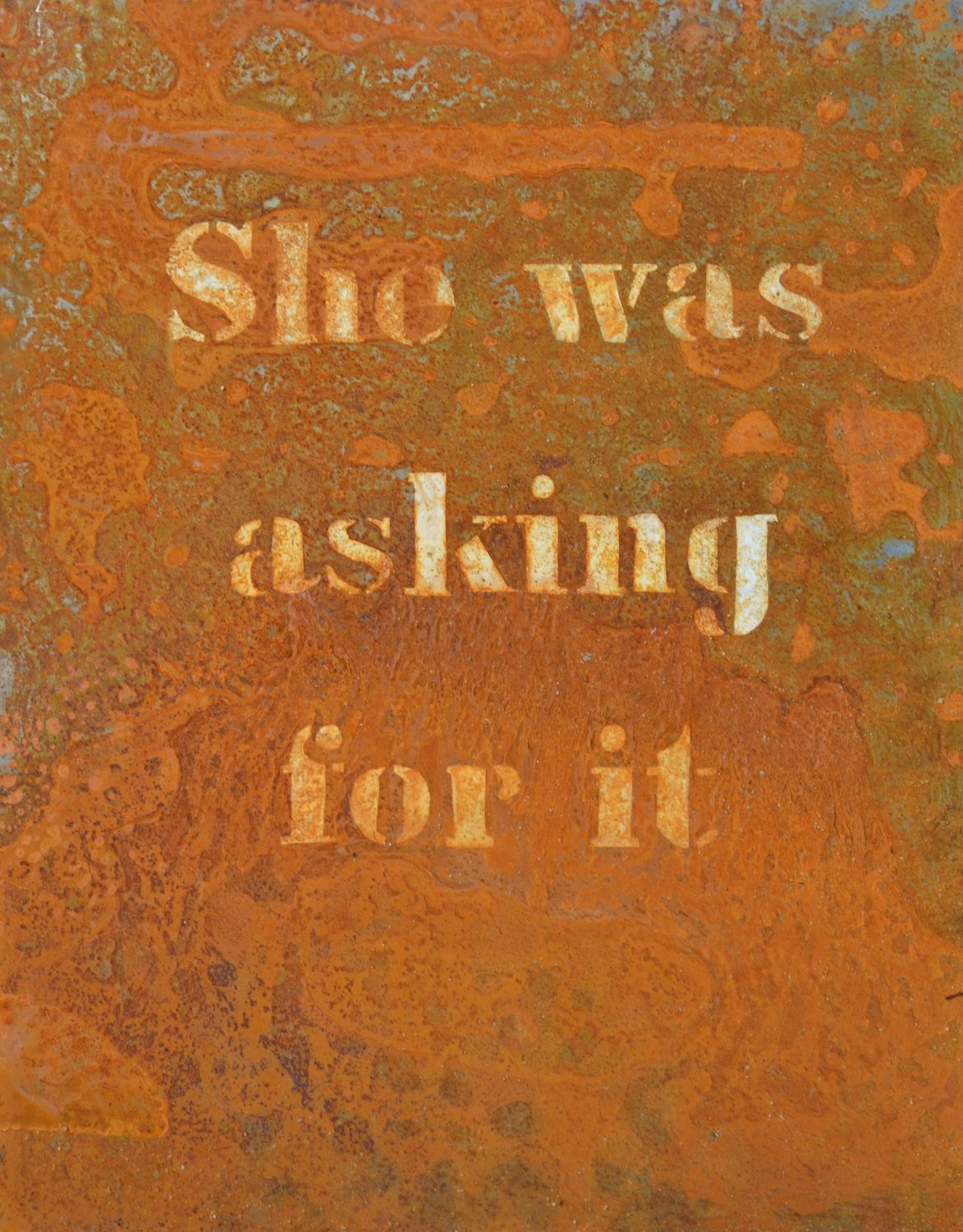 Corten steel panel with victim blaming quote.
