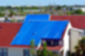 Blue plastic tarpaulin temporarily cover