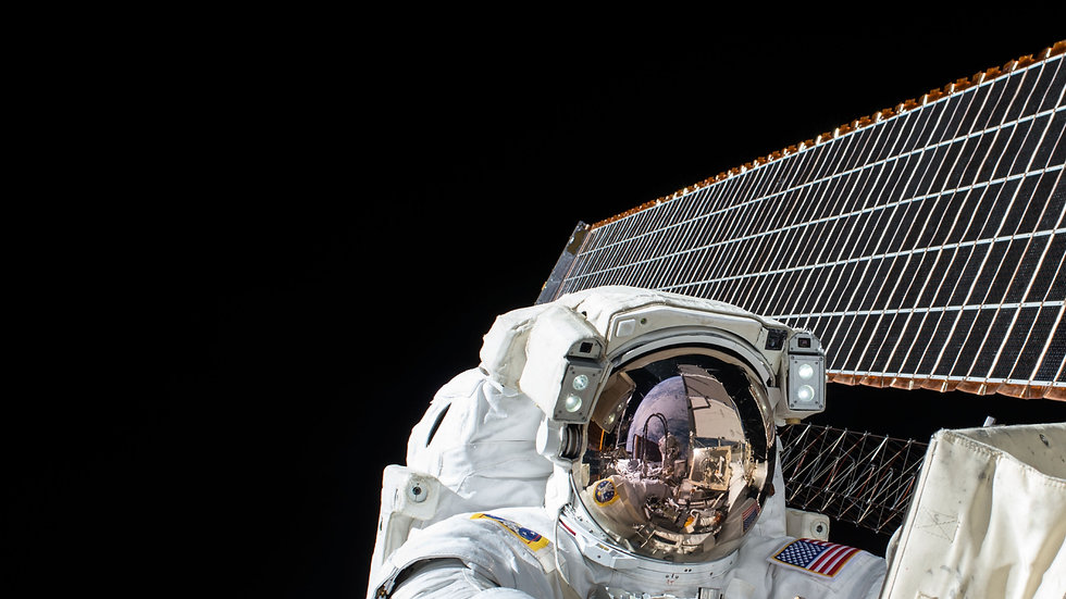 Astronaut in spacesuit next to the ISS