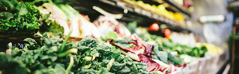 Fresh vegetables in a supermarket aisle