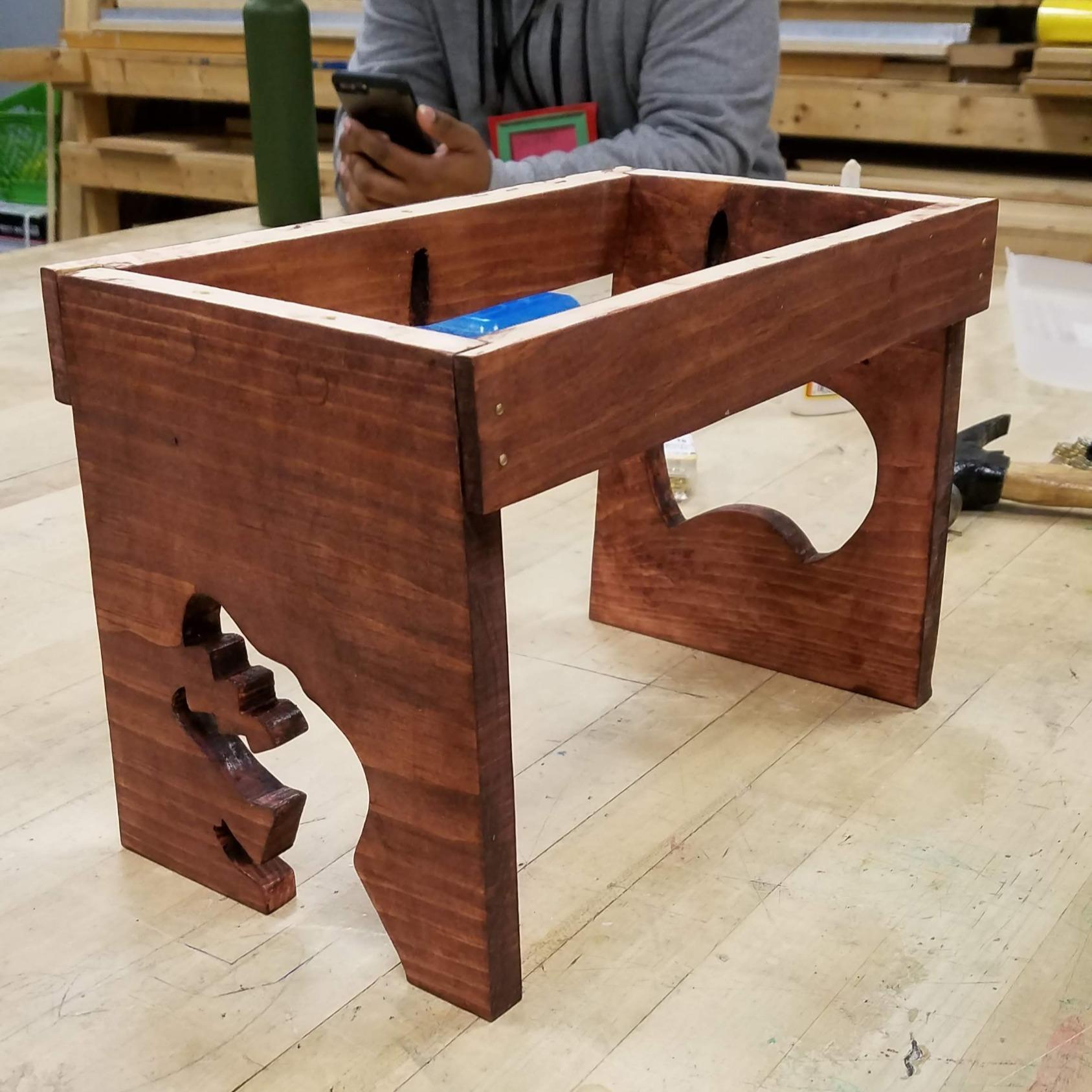 t-rex, dinosaur, kids, woodworking, tech ed, school project, wood shop, brontosaurus, pocket holes, kreg jig, stain, brass, tacks, nails, stain, finished wood, accent, metal, wood grain, dark brown