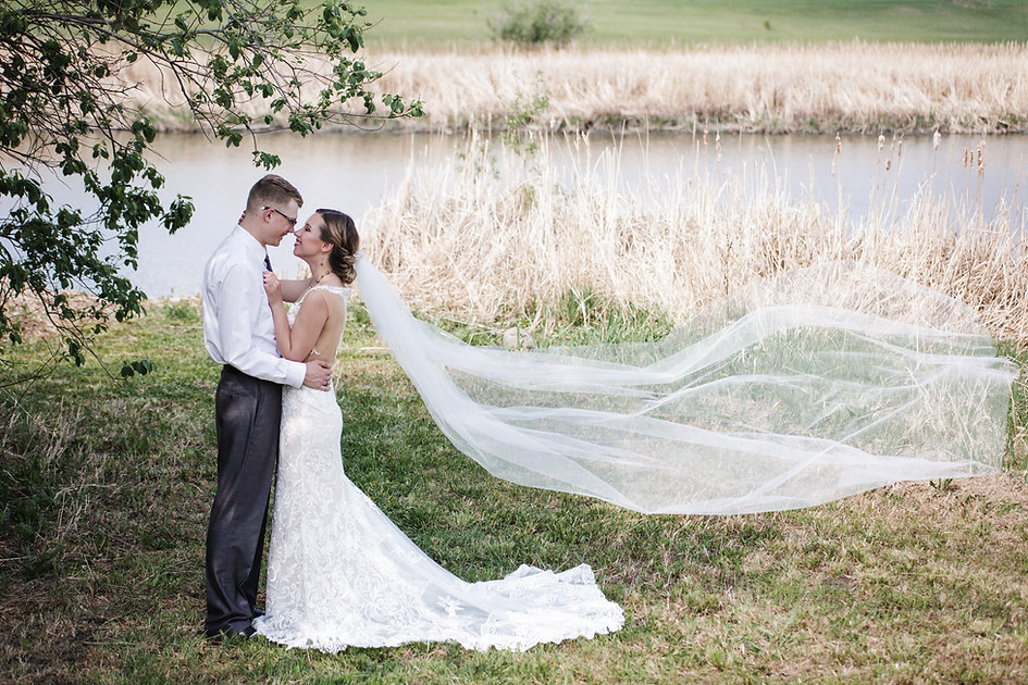 Canoodling creekside in a preloved Calla Blanche gown.  Featuring a handmade veil from Handsewn by Robyn.
