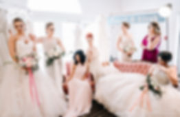 We dry cleanall sizes and styles of wedding gowns for $125 + tax.