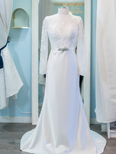 Satin and sleeved a-line wedding dress.