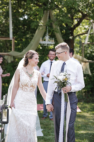 A walk down the aisle at our Conscious Creekside wedding styled shoot featuring a stunning Calla Blanche gown and accented with vintage statement jewelry by Winnipeg designer Vintage Bling.