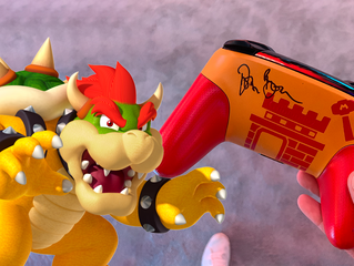Doug Bowser signed my controller!