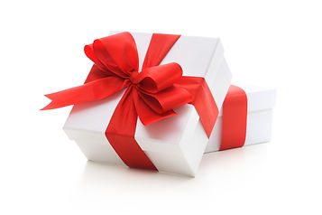 Gift boxes with red ribbon and bow on wh