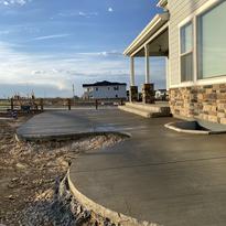 Broom Finish concrete patio with live edge