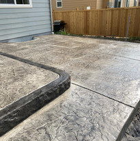 stamped concrete patio with live edge step