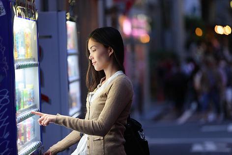 Japan vending machines - Tokyo woman buy