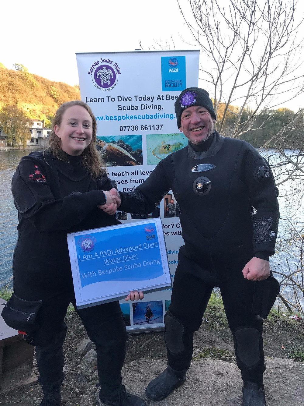 Loretta being congratulated on completing her PADI Advanced Open Water Course