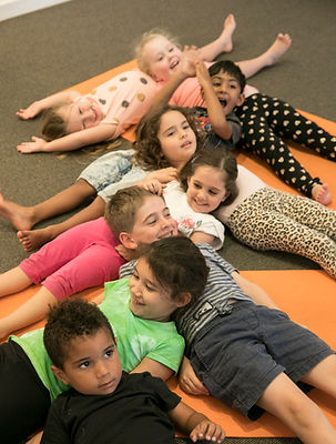 Kids together relaxing in yoga