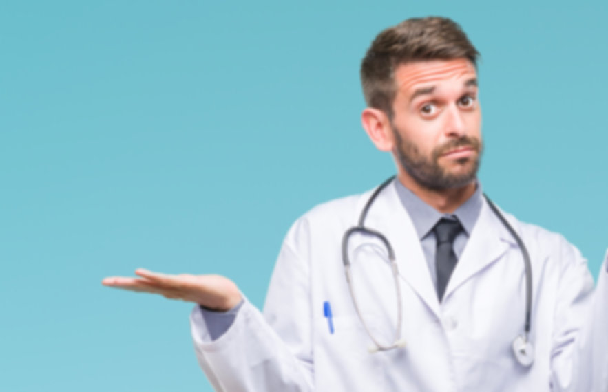 Young handsome doctor man over isolated