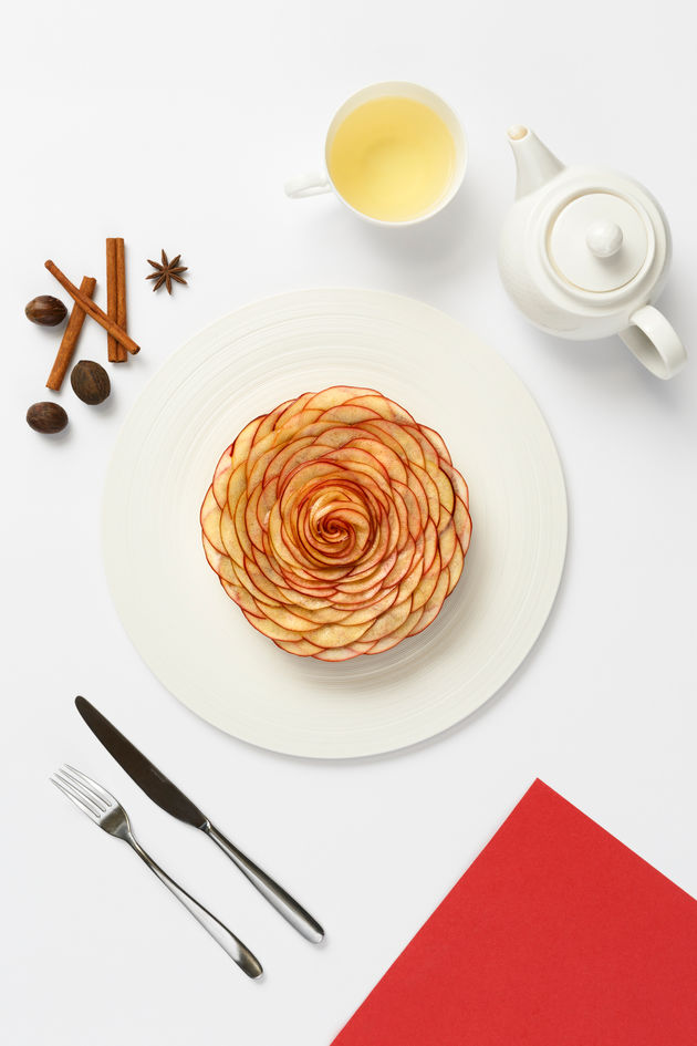 Fine dining pastry with colorful sauce and cutlery on white background shot for Atelier M Dubai