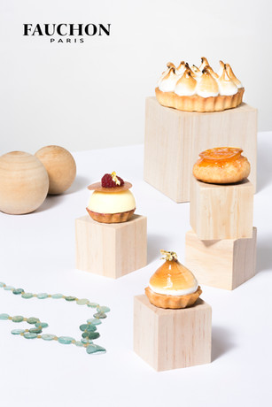 Food photography of Pastry on wooden blocks on white background for Fauchon Dubai 2