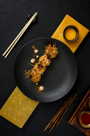 Fine dining dish with different props on black background photographed for Asia Asia restaurant 2