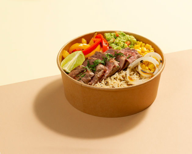 Beef onion lemon corn and capsicum in a recyclable bowl photographed on color paper Bowlful Dubai