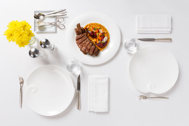 White fine dining table setup photographed from above for Shangri La Abu Dhabi