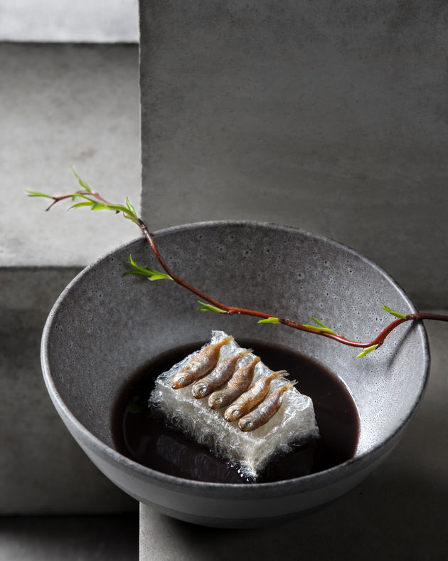 Fish served in Grey Bowl shot on concrete blocks by Dubai Food Photographer Food stylist