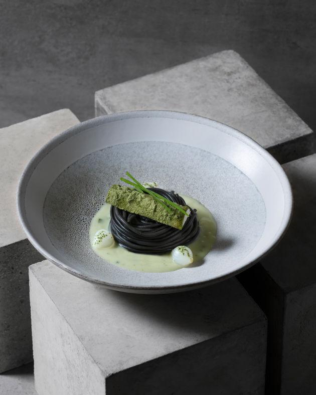Black Spaghetti with mushroom gravy on Concrete by Dubai food photographer at WeShootFood