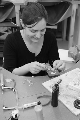 knitted textile designer maker specialising in sterling silver jewellery inspired by knit and  textiles