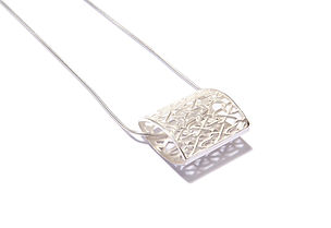 sterling silver knit inspired pendant using a knitted tuck stitch design, with sterling silver snake chain