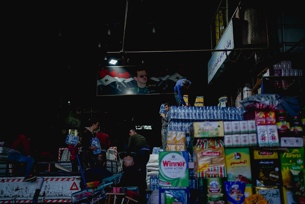 As the currency keeps inflating consumer goods, whose prices have exploded by 250%, are unaffordable to most Syrians. The average wage has now sunk to 14 USD a month.