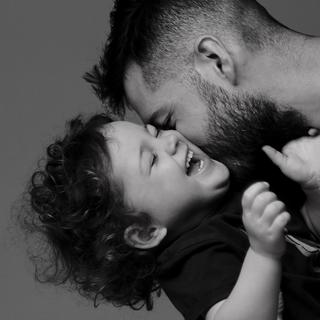 men making fun with child