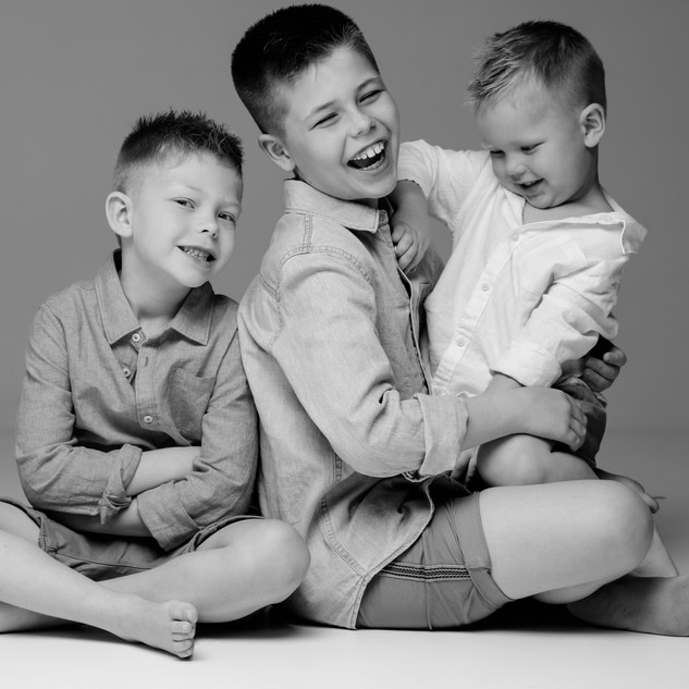 image of three smiling child