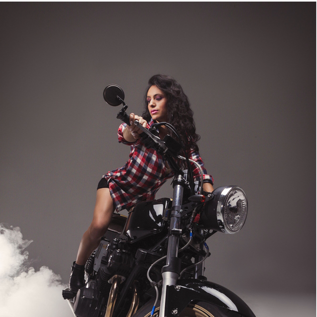 girl posing on bike