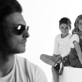 Men posing with two kids image