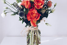 red%20flower%20arrangement%20on%20white%20table_edited.jpg