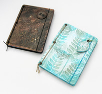 Embossed and painted book covers