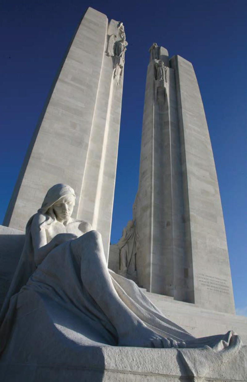 The central figures included in the Vimy Memorial are identified as the Figure of Sacrifice and the Passing of the Sword.