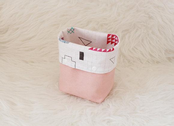 Pochette à débarbouillette rose intérieur dessin géométrique