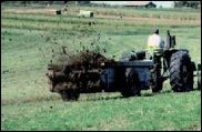 Tractor with a manure spreader attached