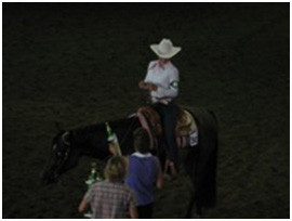 Horse and rider winning a trophy in a western class